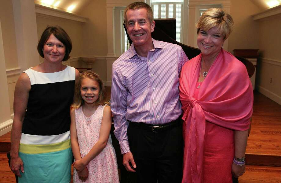 Kaia Close, 10, second from left, performed a solo piano recital at First Presbyterian Church in memory of Catherine Violet Hubbard and Grace McDonnell, both first-graders killed at Sandy Hook, and to raise money for charities  founded in their honor Saturday, May 18, 2013.  Kaia is seen here with with Jenny Hubbard, left, Chris McDonnell and Lynn McDonnell the parents of Catherine Violet Hubbard and Grace McDonnell. Photo: David Ames
