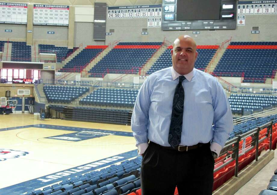 Connecticut Athletic Director Warde Manuel poses for a photograph inside Gampel Pavilion on the University of Connecticut campus in Storrs, Conn., on Monday, May 7, 2012. Manuel said during an Associated Press interview that he has no plans to name Kevin Ollie or anyone else as a coach-in-waiting for the menís basketball program. Coach Jim Calhoun, who turns 70 this month, is expected to return next season, but has not made his plans public.  (AP Photo/Pat Eaton-Robb) Photo: Pat Eaton-Robb, Associated Press / AP