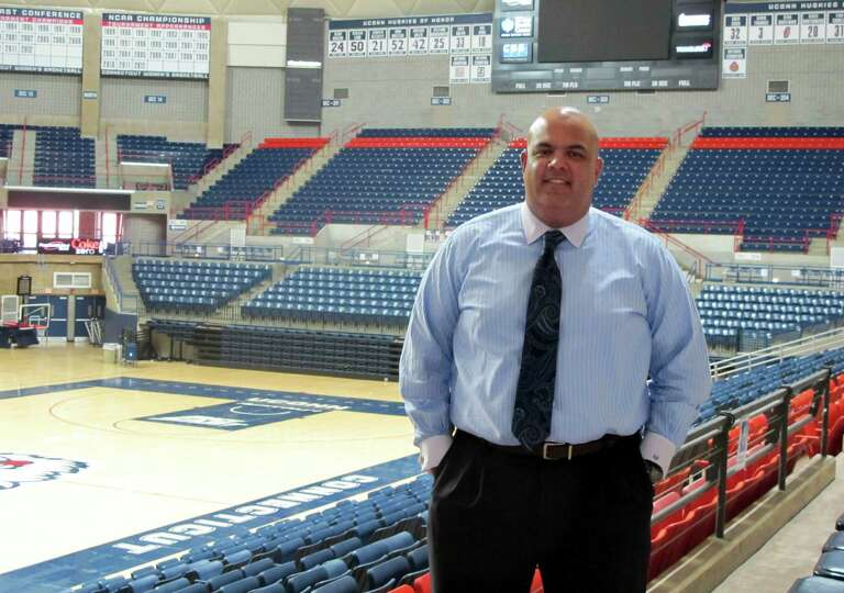 Connecticut Athletic Director Warde Manuel poses for a photograph inside Gampel Pavilion on the U