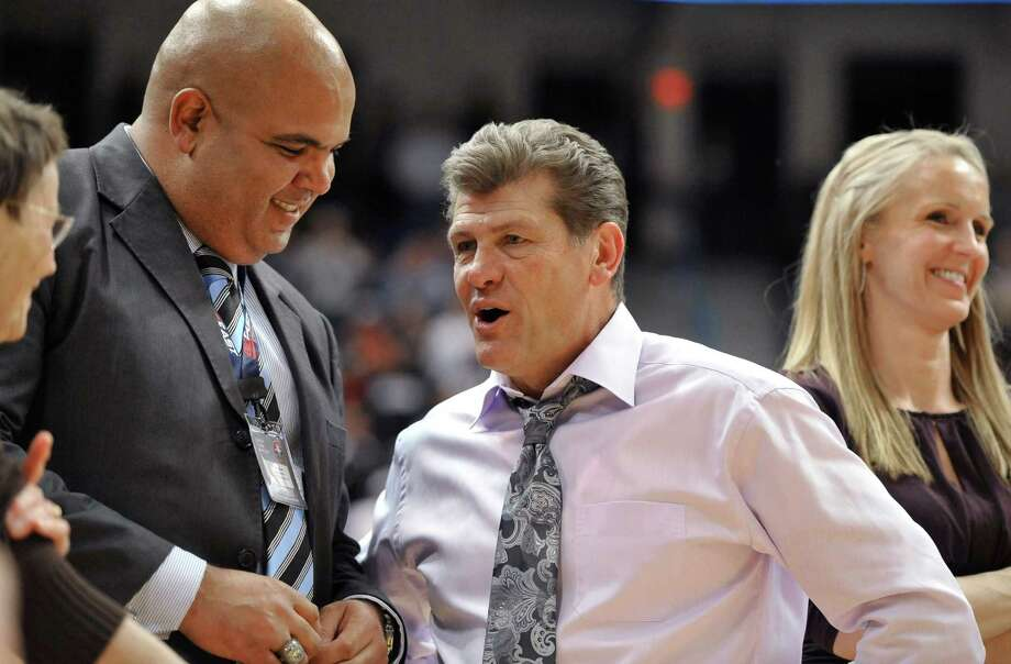 Connecticut coach Geno Auriemma, right, speaks with athletic director Warde Manuel, left, after his 800th career win, 63-54 over Notre Dame in an NCAA college basketball game in the final of the Big East women's tournament in Hartford, Conn., Tuesday, March 6, 2012. (AP Photo/Jessica Hill) Photo: Jessica Hill, Associated Press / AP2012