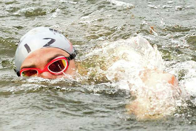 Mike Hermanson (12) swims to the end of the swim portion of the Memorial Hermann Ironman Texas triathlon Saturday, May 18, 2013, in The Woodlands. Photo: Brett Coomer, Houston Chronicle / © 2013 Houston Chronicle