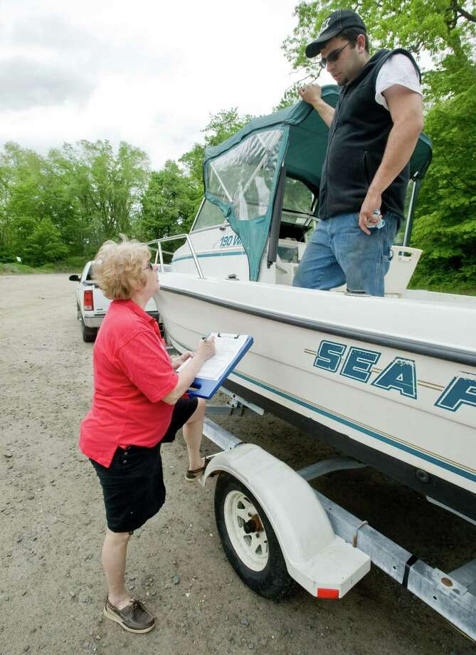 Ginny Schmidt-Gedney of the Candlewood Lake Power Sqaudron talks with boat owner John Neves of New Fairfield while doing a boat safety inspection at the Danbury Town Park boat launch. Saturday, May 18, 2013 Photo: Scott Mullin / The News-Times Freelance