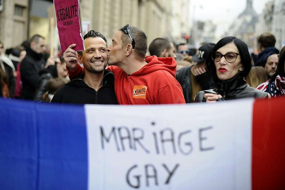 Supporters of same-sex marriage attend a Paris rally in December. France became the 14th country to make such unions legal with a measure that also allows all married couples to adopt. Photo: Lionel Bonaventure, AFP/Getty Images