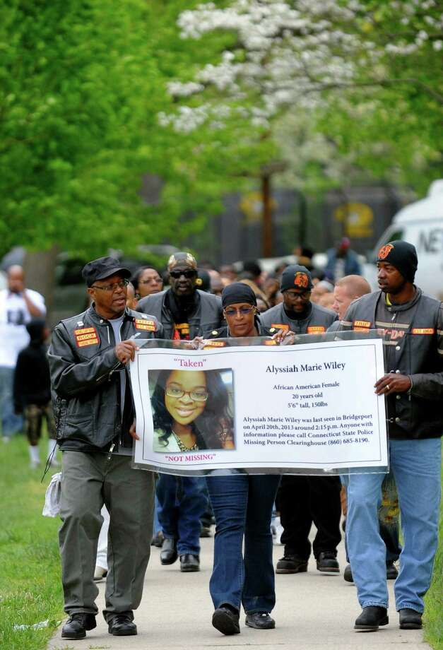 "Members of the motorcycle club Flaming Knights lead a procession to remember Alyssiah Marie Wiley at Beardsley Park in Bridgeport, Conn. on Saturday May 18, 2013. Holding the banner from left to right is George ""Rock"" Hawkins, Victoria ""Lady V"" Staten, and Robert ""Trip"" Trammell. Alyssiah's uncle Malcolm Simmons is a member of the club which brought members from as far away as Los Angeles. Photo: Christian Abraham / Connecticut Post"