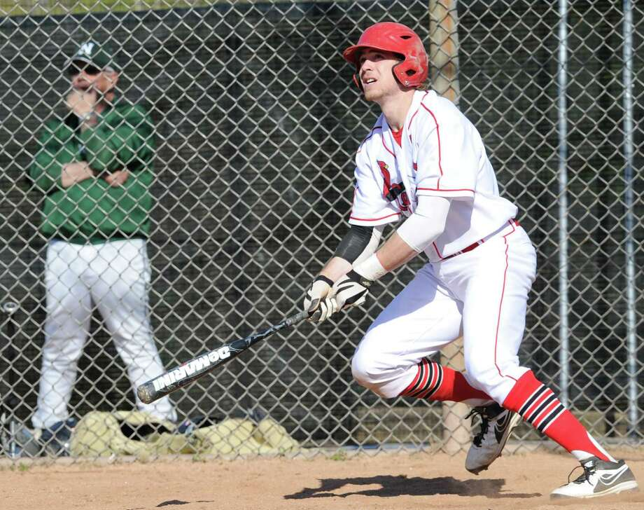 Taylor Olmstead of Greenwich belts a first-pitch three run homer in a win over Norwalk. Olmstead and Cardinals are the top-seeded team in the FCIAC playoffs for the second straight year. Photo: Bob Luckey / Greenwich Time