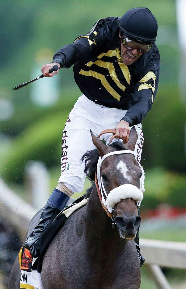 Jockey Gary Stevens celebrates aboard Oxbow after winning the 138th Preakness Stakes horse race at Pimlico Race Course, Saturday, May 18, 2013, in Baltimore. Photo: AP