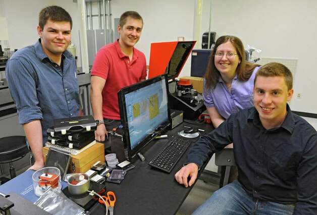 From left, B.S. Nanoscale Engineering students Samuel LaGasse of Niskayuna, Leigh Lydecker IV of Newburgh, Nicole Palmer of South Glens Falls and Michael Briggs of Cohoes gather around a computer in a lab at Albany NanoTech Wednesday, May 15, 2013 in Albany, N.Y. They are the first undergrads to graduate from Albany NanoTech.  (Lori Van Buren / Times Union) Photo: Lori Van Buren / 00022447A