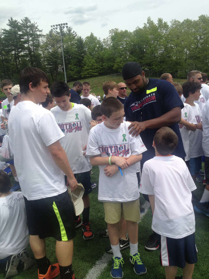 Patriots linebacker Jerod Mayo signs autographs for kids at the Football For You football and Cheerleading Clinic at Newtown High School on Saturday, May 18, 2013. (Photo: Rich Gregory)