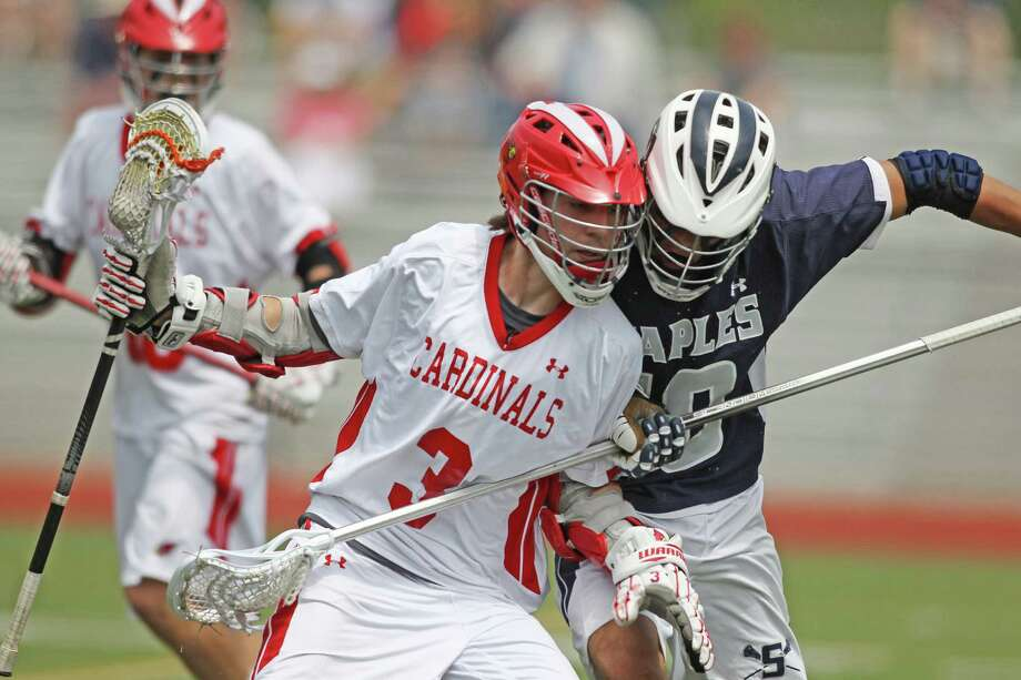 Greenwich High School middie Kyle Foote goes toe to toe with Staples counterpart Lance Lonergan during quarterfinal  FCIAC ation in Greenwich on Saturday. The Cardinals won the game 11-8 to advance to the semi final found. © J. Gregory Raymond for Greenwich Time Photo: J. Gregory Raymond / Stamford Advocate Freelance;  © J. Gregory Raymond
