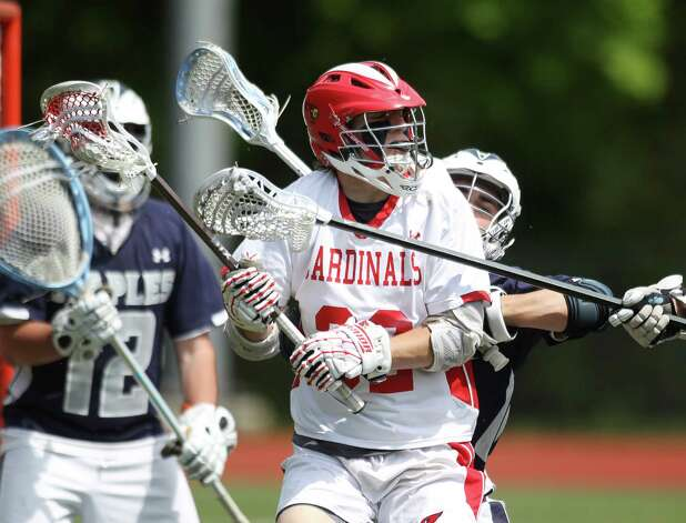Greenwich High School middie Alec Orapall finds his path to the Staples goal blocked by Staples defenders during quarterfinal lacrosse action in Greenwich on Saturday. Greenwich won to advance to the next round, 11-8. © J. Gregory Raymond for The Greenwich Time Photo: J. Gregory Raymond / Stamford Advocate Freelance;  © J. Gregory Raymond