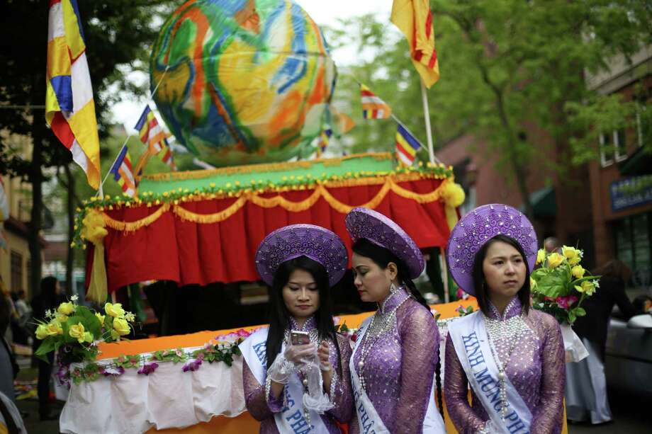 Participants prepare to march during a parade in the International District celebrating the birth of Buddha. Dozens of people honored Buddha by marching through the streets of the International District. Photographed on Saturday, May 18, 2013. Photo: JOSHUA TRUJILLO, SEATTLEPI.COM / SEATTLEPI.COM