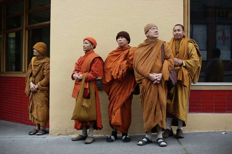 Buddhist monks prepare to march during a parade in the International District celebrating the birth of Buddha. Dozens of people honored Buddha by marching through the streets of the International District. Photographed on Saturday, May 18, 2013. Photo: JOSHUA TRUJILLO, SEATTLEPI.COM / SEATTLEPI.COM