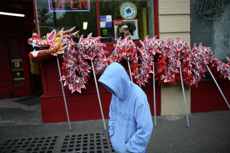A dragon dancer waits to perform during a parade in the International District celebrating the birth of Buddha. Dozens of people honored Buddha by marching through the streets of the International District. Photographed on Saturday, May 18, 2013. Photo: JOSHUA TRUJILLO, SEATTLEPI.COM / SEATTLEPI.COM