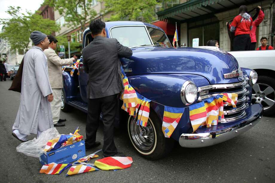 A car is decorated during a parade in the International District celebrating the birth of Buddha. Dozens of people honored Buddha by marching through the streets of the International District. Photographed on Saturday, May 18, 2013. Photo: JOSHUA TRUJILLO, SEATTLEPI.COM / SEATTLEPI.COM