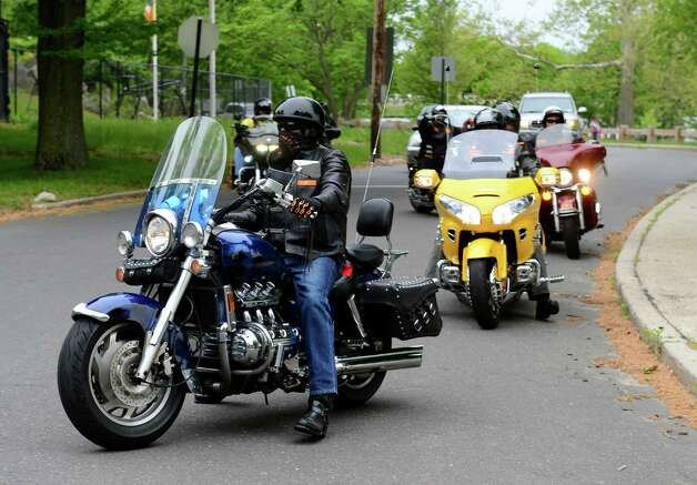 Members of the motorcycle club Flaming Knights arrive to attend a procession to remember murder victim Alyssiah Marie Wiley at Beardsley Park in Bridgeport, Conn. on Saturday May 18, 2013. Alyssiah's uncle Malcolm Simmons is a member of the club which brought members from as far away as Los Angeles. Photo: Christian Abraham / Connecticut Post