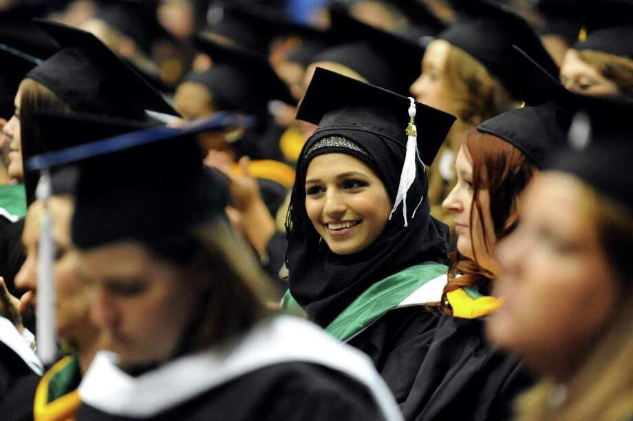 Graduate Hosna Hashimi, center, listens to the speakers during The Sage Colleges commencement on Saturday, May 18, 2013, at Rensselaer Polytechnic Institute in Troy, N.Y. (Cindy Schultz / Times Union) Photo: Cindy Schultz / 10022130A