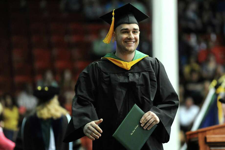 Graduate Elijah Braemer recieves his diploma during The Sage Colleges commencement on Saturday, May 18, 2013, at Rensselaer Polytechnic Institute in Troy, N.Y. (Cindy Schultz / Times Union) Photo: Cindy Schultz / 10022130A