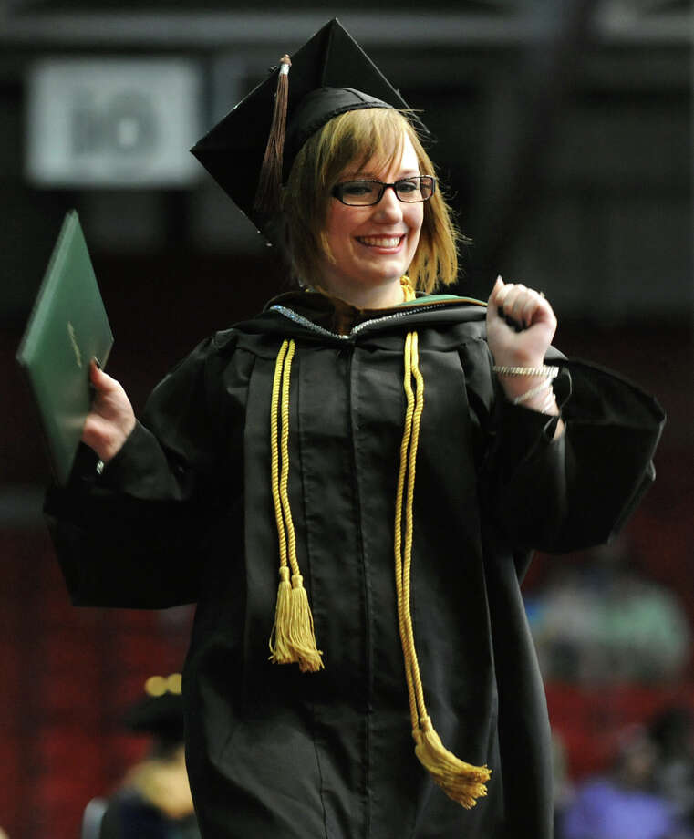 Graduate amanda Miller celebrates receiving her diploma during The Sage Colleges commencement on Saturday, May 18, 2013, at Rensselaer Polytechnic Institute in Troy, N.Y. (Cindy Schultz / Times Union) Photo: Cindy Schultz / 10022130A