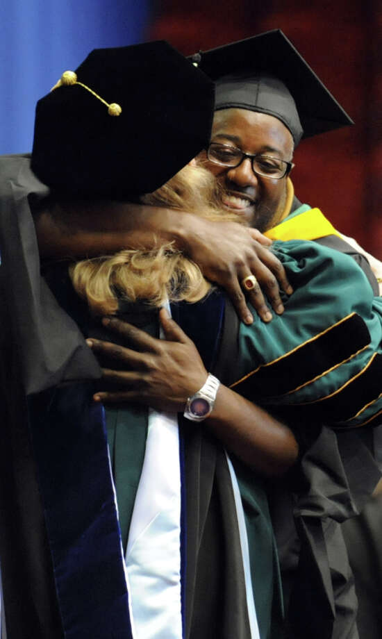Graduate George Tiggle, right, embraces president Susan Scrimshaw during The Sage Colleges commencement on Saturday, May 18, 2013, at Rensselaer Polytechnic Institute in Troy, N.Y. (Cindy Schultz / Times Union) Photo: Cindy Schultz / 10022130A