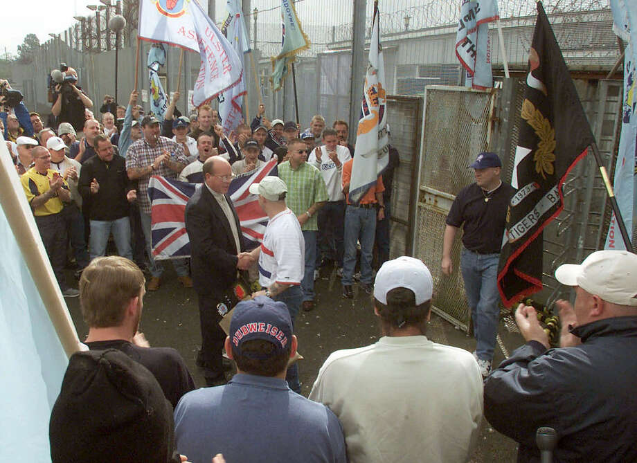 Ulster Freedom Fighters are welcomed as loyalist prisoners are released from the Maze prison near Belfast, Northern Ireland, in July 2000. The prison closed shortly afterward. Photo: Associated Press File Photo