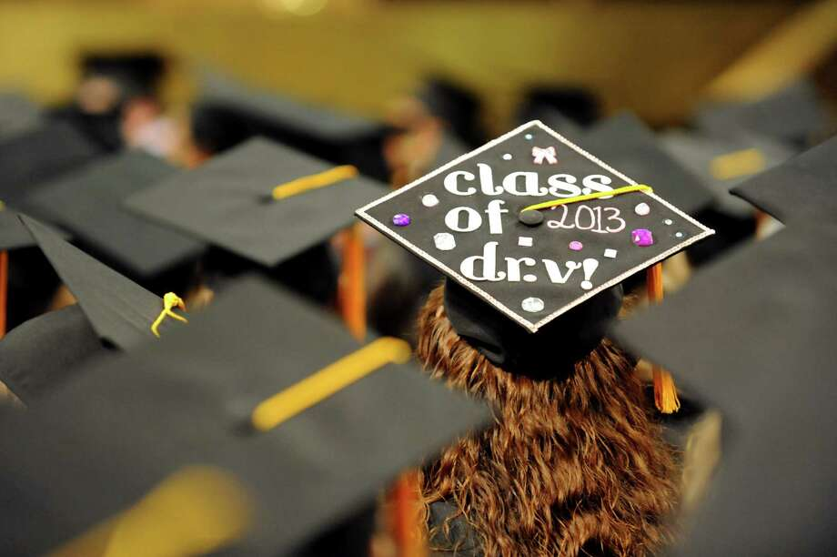 A graduate wears a customized mortar board during the Albany College of Pharmacy college commencement on Saturday, May 18, 2013, at the Convention Center in Albany, N.Y. (Cindy Schultz / Times Union) Photo: Cindy Schultz / 10022116A