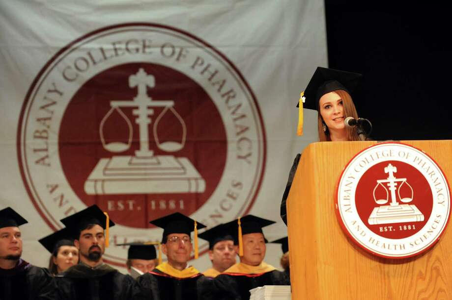 Graduate Sarah DeRuosi, right, delivers the student address during the Albany College of Pharmacy college commencement on Saturday, May 18, 2013, at the Convention Center in Albany, N.Y. (Cindy Schultz / Times Union) Photo: Cindy Schultz / 10022116A