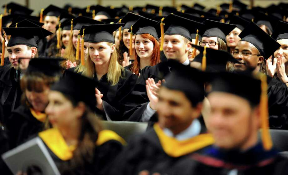 Graduates applaud the speakers during the Albany College of Pharmacy college commencement on Saturday, May 18, 2013, at the Convention Center in Albany, N.Y. (Cindy Schultz / Times Union) Photo: Cindy Schultz / 10022116A