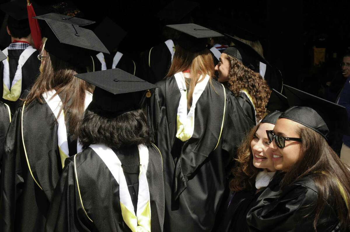 Graduates joyfully process during the Skidmore 102nd college commencement at SPAC on Saturday May 18, 2013 in Saratoga Springs, N.Y. (Michael P. Farrell/Times Union)