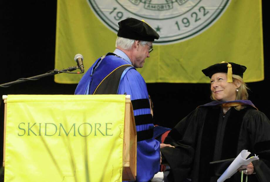 Skidmore president Philip A. Glotzbach presents Cynthia Blum Carroll with an honorary Doctors of Laws degree during the Skidmore 102nd college commencement at SPAC on Saturday May 18, 2013 in Saratoga Springs, N.Y. (Michael P. Farrell/Times Union) Photo: Michael P. Farrell