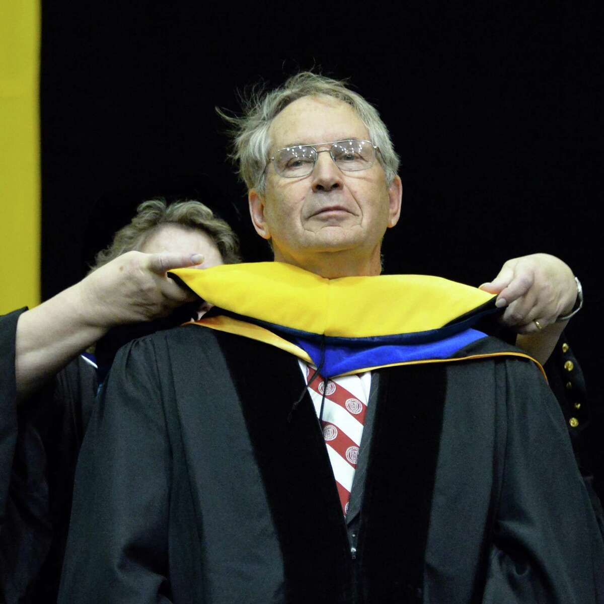 Co-founder of Advion, John D. Henion recieves an honoring degree during UAlbany Graduate college commencement ceremonies in Albany, NY Saturday May 18, 2013. (John Carl D'Annibale / Times Union)