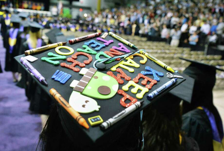 A graduate's decorated cap during UAlbany Graduate college commencement ceremonies in Albany, NY Saturday May 18, 2013.  (John Carl D'Annibale / Times Union) Photo: John Carl D'Annibale / 10022137A