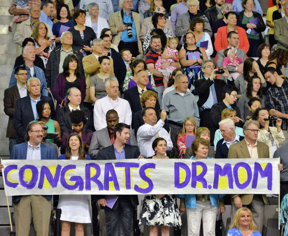 The family of Dr. Lenore Horowitz of Clifton Park holds up a banner at the start of UAlbany Graduate college commencement ceremonies in Albany, NY Saturday May 18, 2013.  (John Carl D'Annibale / Times Union) Photo: John Carl D'Annibale / 10022137A