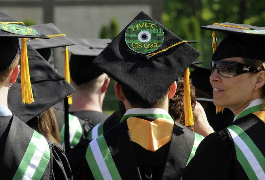 Graduates take their seats during the HVCC 56th annual college commencement on Saturday May 18, 2013 in Troy, N.Y. (Michael P. Farrell/Times Union) Photo: Michael P. Farrell