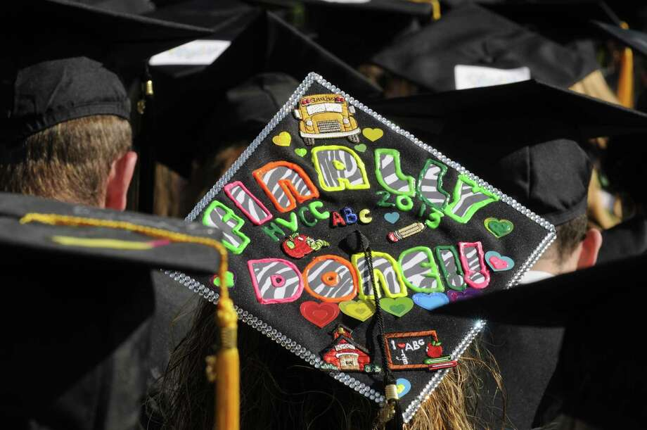 "A graduates cap reads "" Finally Done"" during the HVCC 56th annual college commencement on Saturday May 18, 2013 in Troy, N.Y. (Michael P. Farrell/Times Union) Photo: Michael P. Farrell"