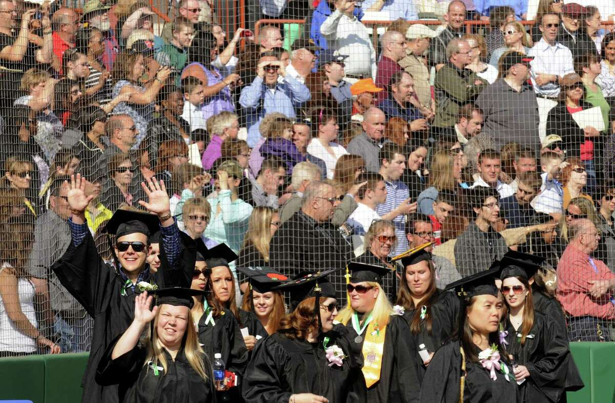 Graduates joyfully process during the HVCC 56th annual college commencement on Saturday May 18, 2013 in Troy, N.Y. (Michael P. Farrell/Times Union)
