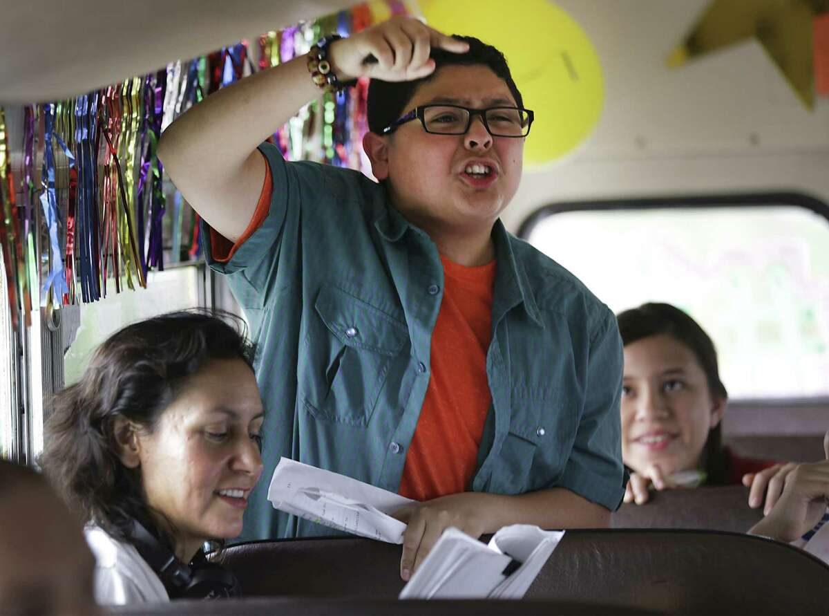 Rico Rodriquez playing the part of Jose, delivers a line on the school bus during the filming of a scene.
