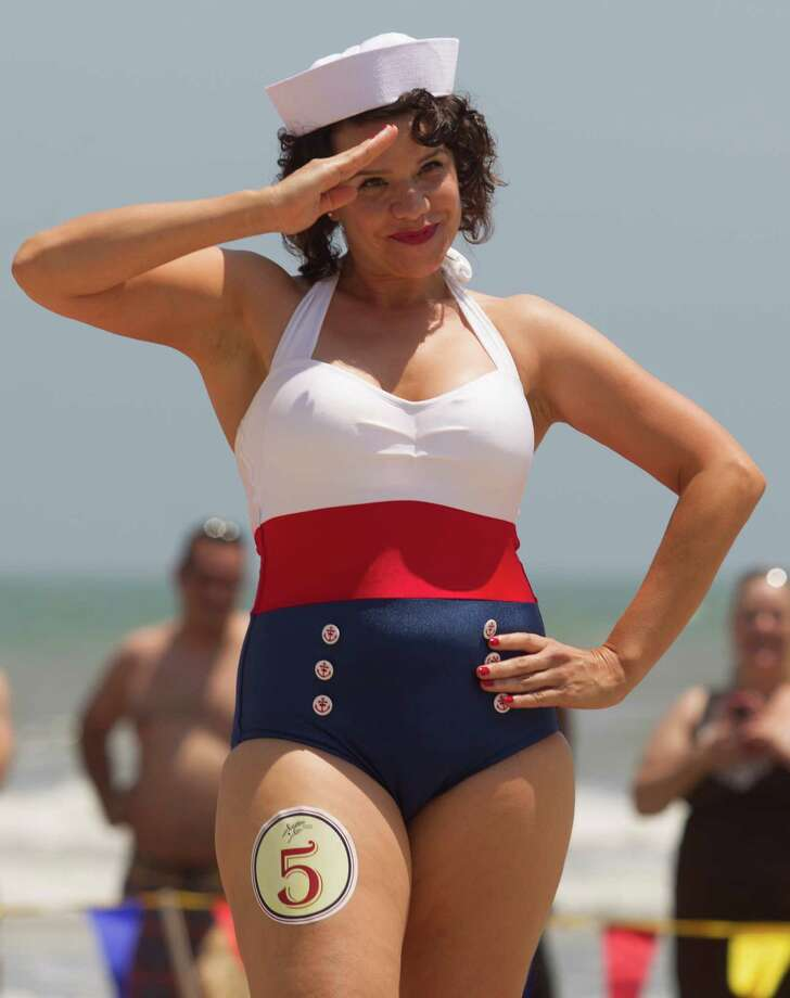 Maria Zayas salutes the crowd in her sailor bathing suit during the Beach Revue bathing beauties contest on Saturday, May 18, 2013, in Galveston. Forty contestants wore 20's and 30's period style bathing suits and competed for cash prizes during this crowd favorite event. Photo: J. Patric Schneider, For The Chronicle / © 2013 Houston Chronicle