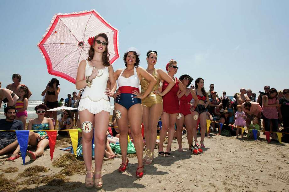 From left to right, Secelia Garrett-King, Maria Zayas, Melinda Quijas, Charlsie Anderson, April Fox, and Brittany White show off their bathing suits during the Beach Revue bathing beauties contest on Saturday, May 18, 2013, in Galveston. Forty contestants wore 20's and 30's period style bathing suits and competed for cash prizes during this crowd favorite event. Photo: J. Patric Schneider, For The Chronicle / © 2013 Houston Chronicle