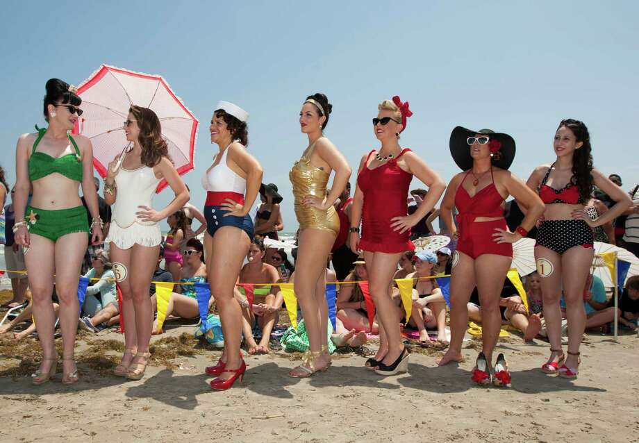 From left to right, Dana Blue, Secelia Garrett-King, Maria Zayas, Melinda Quijas, Charlsie Anderson, April Fox, and Brittany White show off their bathing suits during the Beach Revue bathing beauties contest on Saturday, May 18, 2013, in Galveston. Forty contestants wore 20's and 30's period style bathing suits and competed for cash prizes during this crowd favorite event. Photo: J. Patric Schneider, For The Chronicle / © 2013 Houston Chronicle