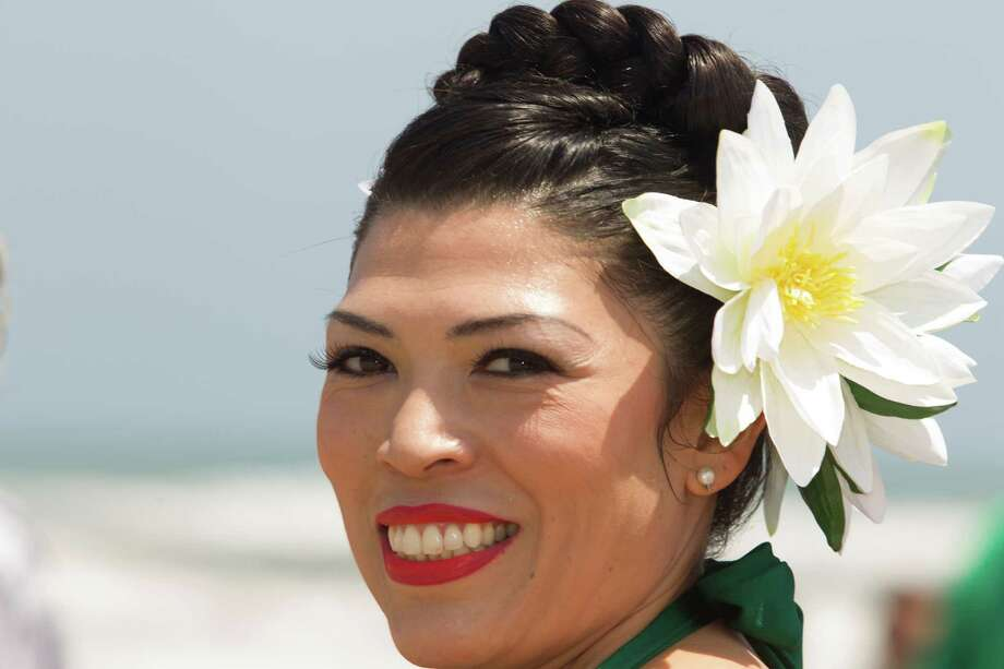 Julissa Cantu wears a flower in her hair during the Beach Revue bathing beauties contest on Saturday, May 18, 2013, in Galveston. Forty contestants wore 20's and 30's period style bathing suits and competed for cash prizes during this crowd favorite event. Photo: J. Patric Schneider, For The Chronicle / © 2013 Houston Chronicle