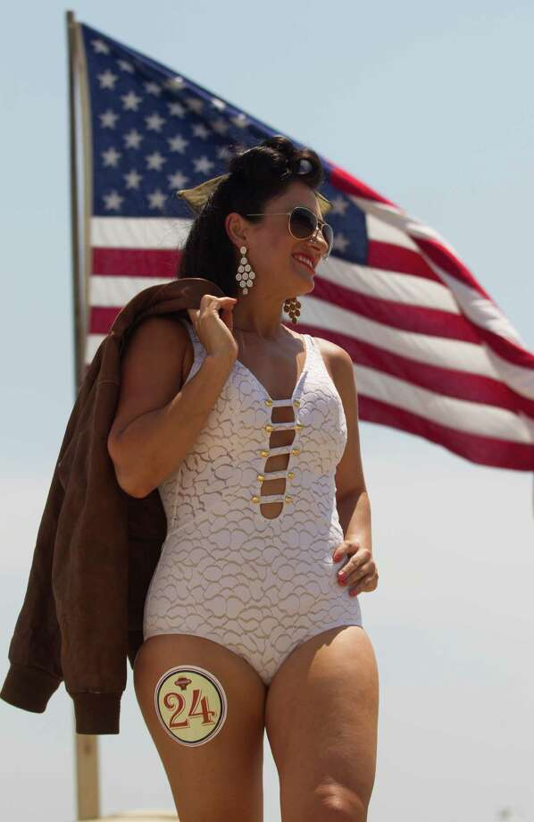 Elizabeth Rogers shows off her bathing suit during the Beach Revue bathing beauties contest on Saturday, May 18, 2013, in Galveston. Forty contestants wore 20's and 30's period style bathing suits and competed for cash prizes during this crowd favorite event. Photo: J. Patric Schneider, For The Chronicle / © 2013 Houston Chronicle