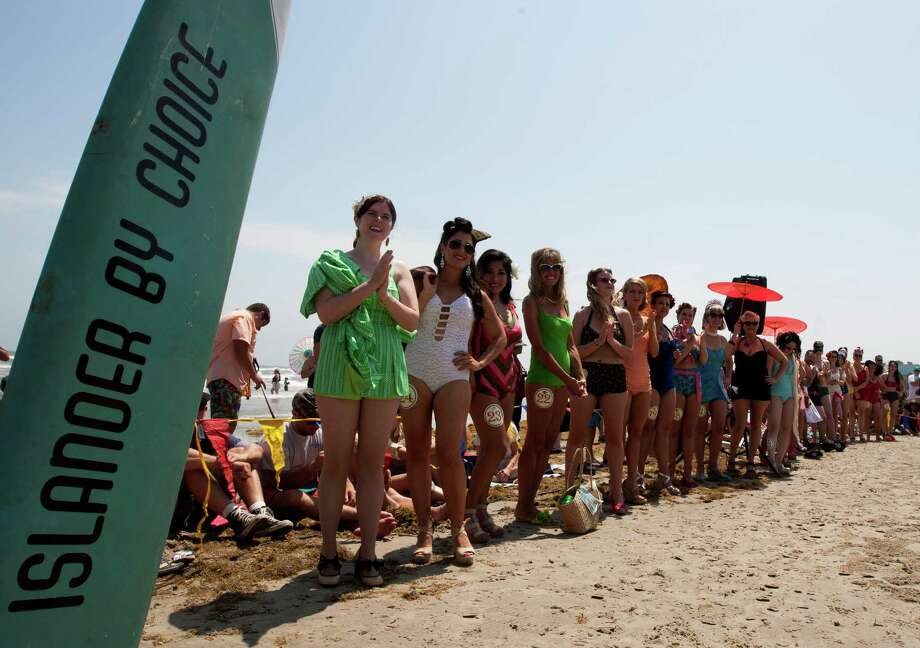 Contestants participate in the Beach Revue bathing beauties contest on Saturday, May 18, 2013, in Galveston. Forty contestants wore 20's and 30's period style bathing suits and competed for cash prizes during this crowd favorite event. Photo: J. Patric Schneider, For The Chronicle / © 2013 Houston Chronicle