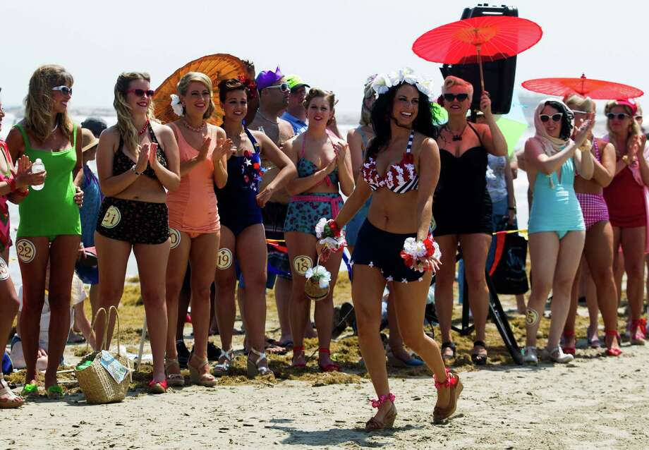 Summer Sanderson shows off her bathing suit during the Beach Revue bathing beauties contest on Saturday, May 18, 2013, in Galveston. Forty contestants wore 20's and 30's period style bathing suits and competed for cash prizes during this crowd favorite event. Photo: J. Patric Schneider, For The Chronicle / © 2013 Houston Chronicle