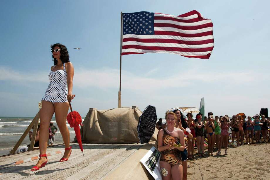 Christina White shows off her bathing suit during the Beach Revue bathing beauties contest on Saturday, May 18, 2013, in Galveston. Forty contestants wore 20's and 30's period style bathing suits and competed for cash prizes during this crowd favorite event. Photo: J. Patric Schneider, For The Chronicle / © 2013 Houston Chronicle