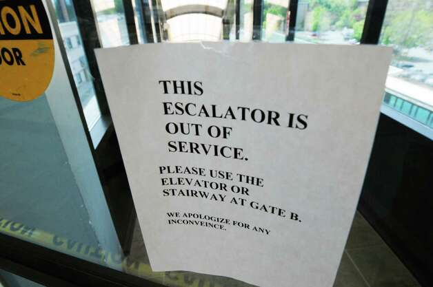 A sign warns rail travelers that the Albany-Rensselaer Train Station escalators are out of order Friday afternoon, May 17, 2013, in Rensselaer, N.Y.  Both of the station?s escalators are under repair. (Will Waldron/Times Union) Photo: Will Waldron