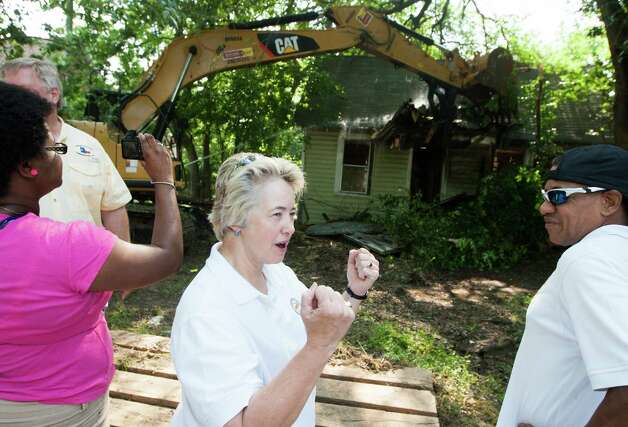 Mayor Annise Parker celebrates as an abandoned house off of Lavender St. is demolished during the fourth annual Demo Day on Saturday, May 18, 2013, in Houston. Demo Day launches Mayor Parker's 2013 Demolition Initiative, which includes the removal of 136 dangerous buildings throughout Houston over the next two months. Photo: J. Patric Schneider, For The Chronicle / © 2013 Houston Chronicle