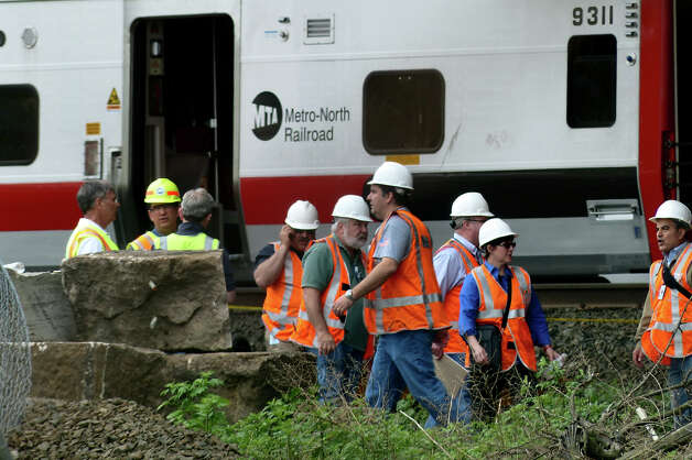 Metro-North Railroad officials including President howard Permut tour the scene of Friday's train derailment in Bridgeport, Conn. on Saturday May 18, 2013. Photo: Christian Abraham / Connecticut Post