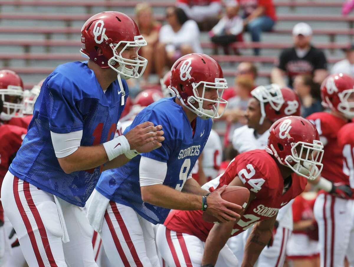 Oklahoma quarterbacks Blake Bell (10) and Trevor Knight (9) wait for snaps before the Oklahoma spring intra-squad NCAA college football game in Norman, Okla., Saturday, April 13, 2013. (AP Photo/Sue Ogrocki)
