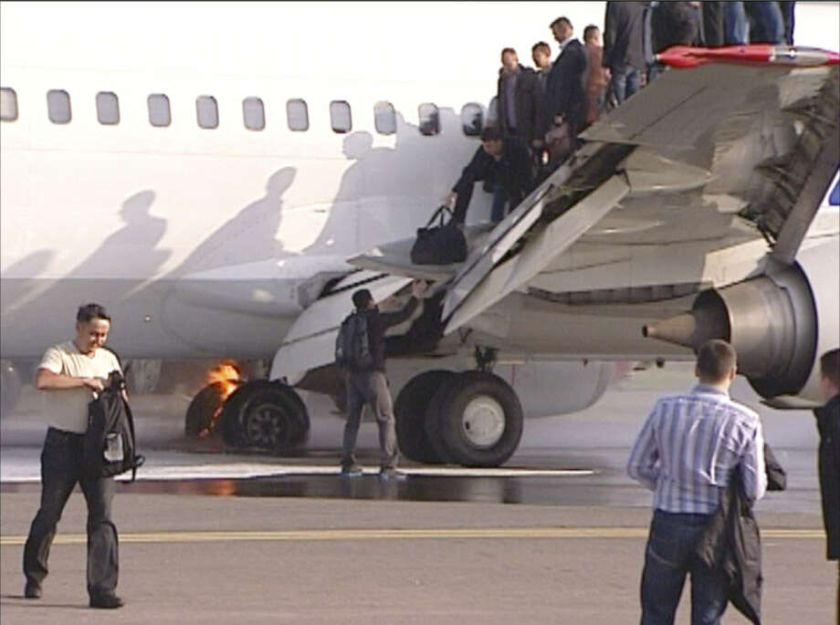In an image from AP video, passengers are evacuated from a Boeing 737 belonging to Russian carrier UTair at a Moscow airport after a fire during the landing. No one was injured. Photo: Associated Press