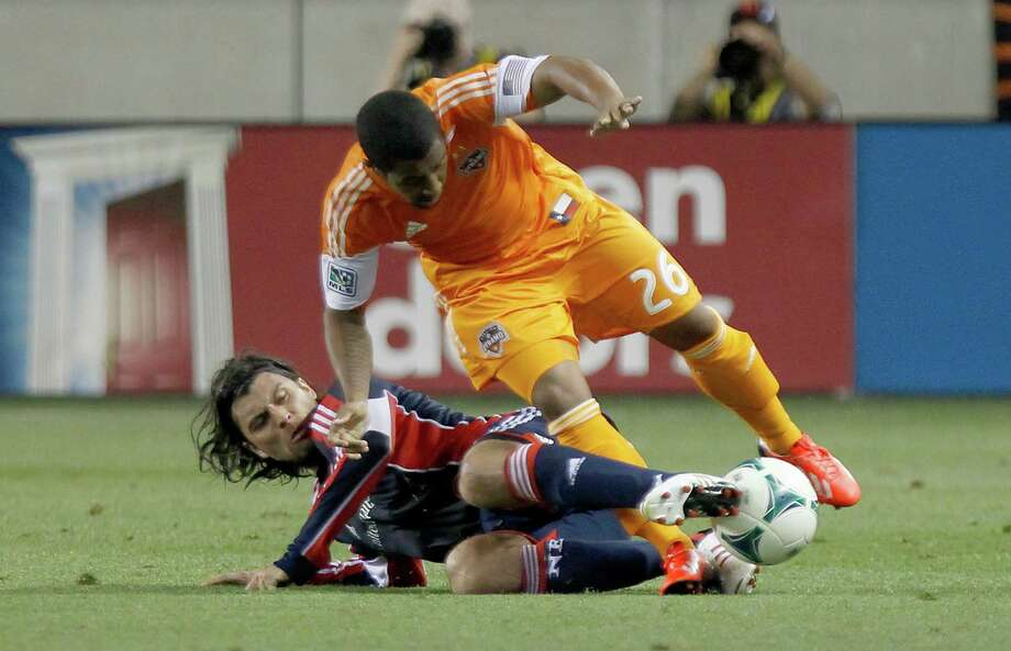 Revolution 2, Dynamo 0New England Revolution midfielder Juan Toja (7) slide tackles Houston Dynamo midfielder Corey Ashe (26) in the first half at BBVA Compass Stadium in Houston, Texas. Photo: Thomas B. Shea, For The Chronicle / © 2013 Thomas B. Shea